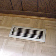 Standard metal vent in parquet floor